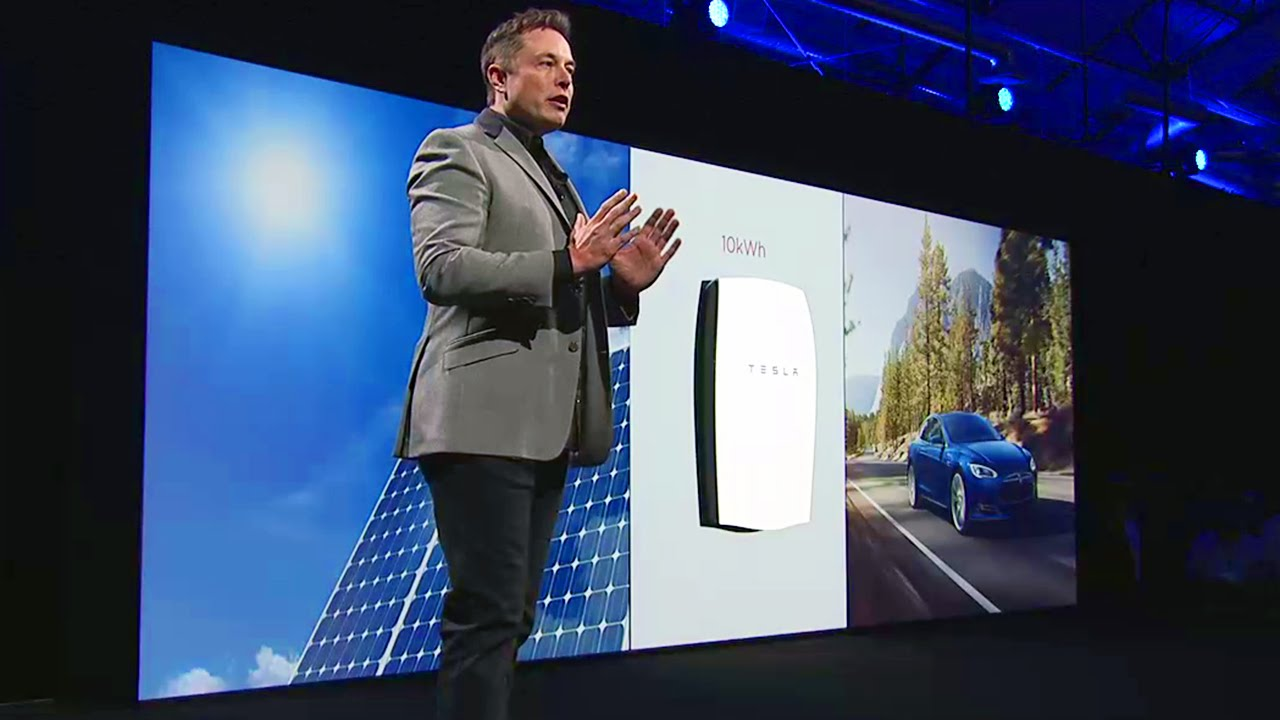 Elon Musk with solar panel tesla battery